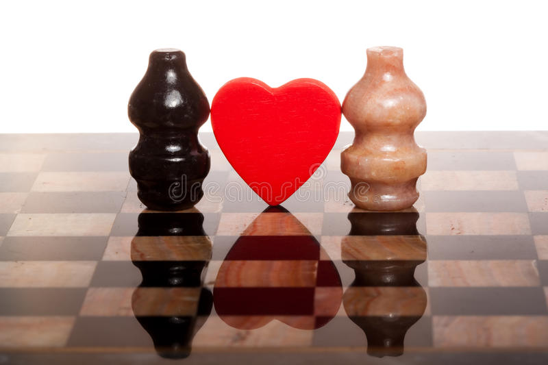 Two romantic chessmans on marble chess-board stock photos