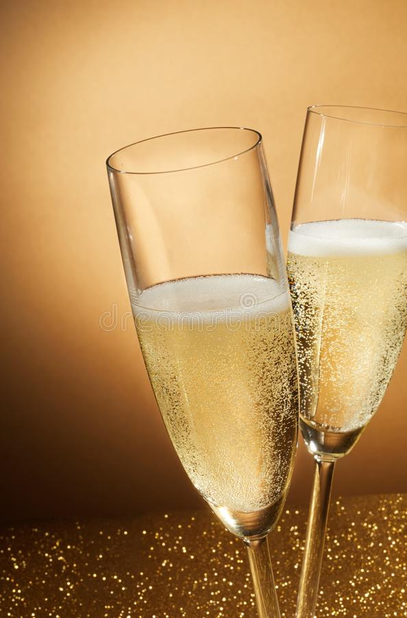 Two romantic flutes of sparkling champagne royalty free stock photos