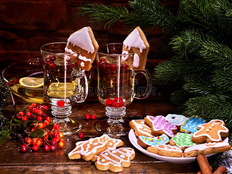 Two romantic glass of hot punch and lemon. Christmas cookies on the background of spruce branches stock photo