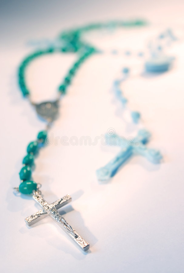 Two rosaries. Two colored rosaries royalty free stock photo
