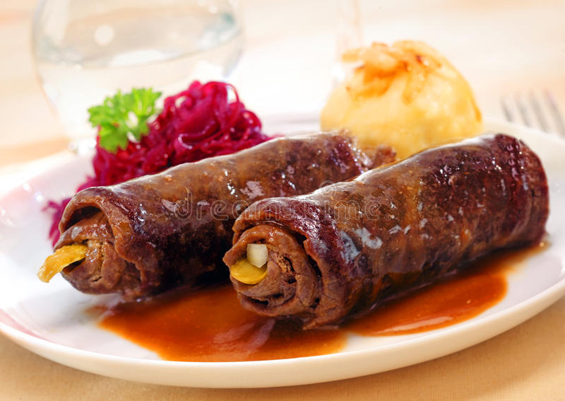 Two roulades or beef olives. Two delicious roulades or beef olives made from thinly sliced rolled beef around a vegetable or pickle stuffing served in rich gravy stock images