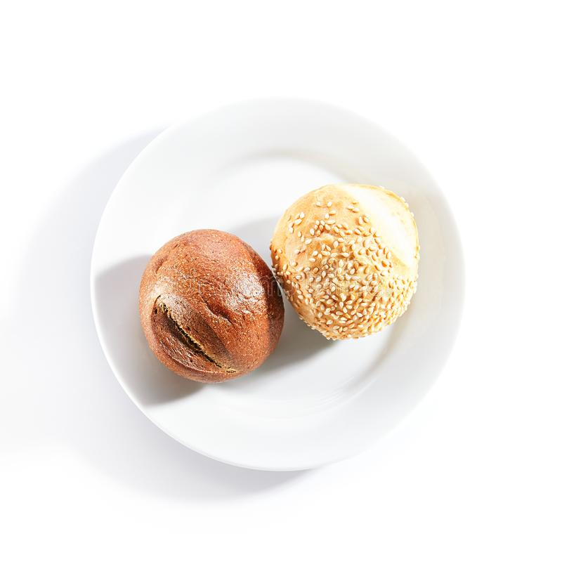 Two Round Buns of Rye and Wheat Flour with Sesame Seeds Top View royalty free stock images