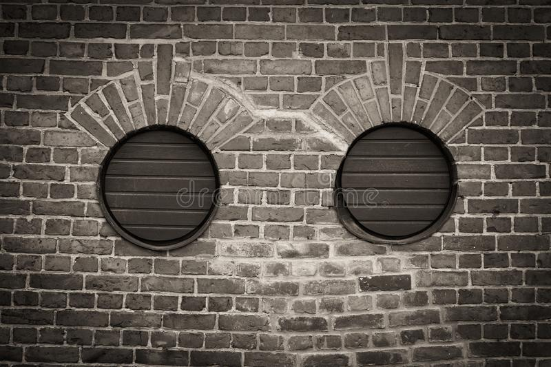 Two round holes in brick wall stock photo