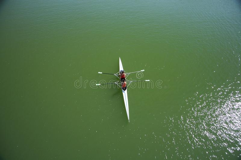 Two rowers. Canoe double at Guadalquivir river in Seville Spain royalty free stock photography