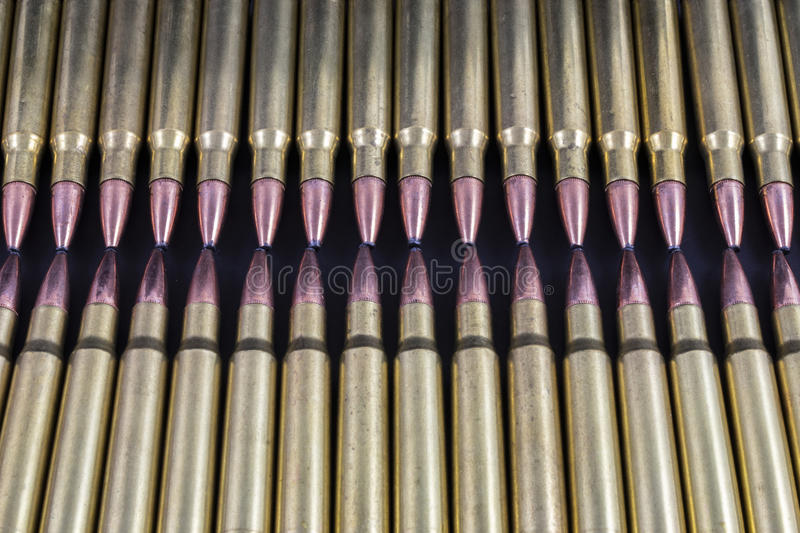 Two rows of bullets touching royalty free stock photo