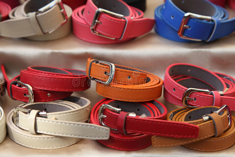 Two rows of multicolored women's leather belts. Two rows of women's leather belts royalty free stock image