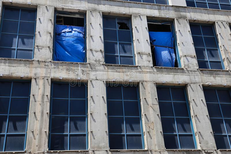Two rows of windows on the building façade. High glass windows on the building facade stock photography