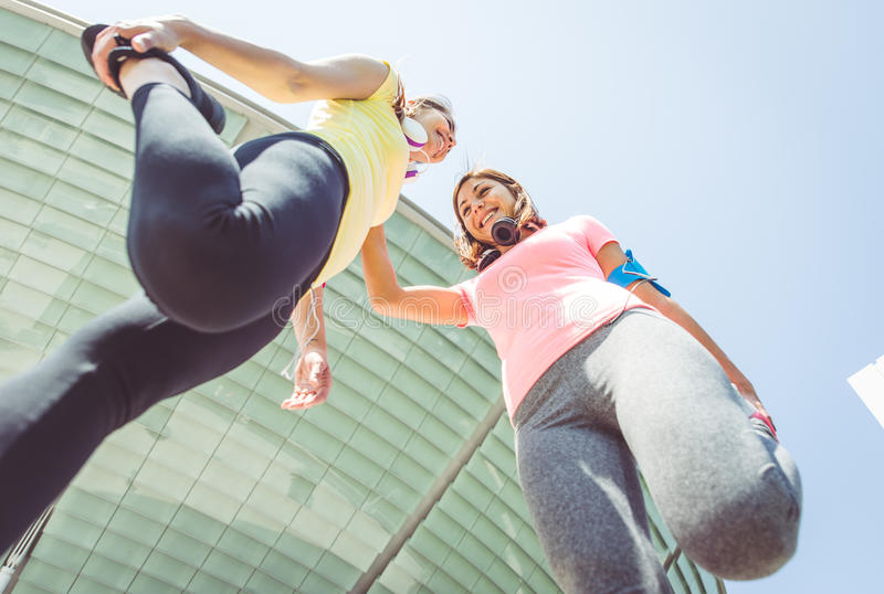 Two runners making stretching royalty free stock photos