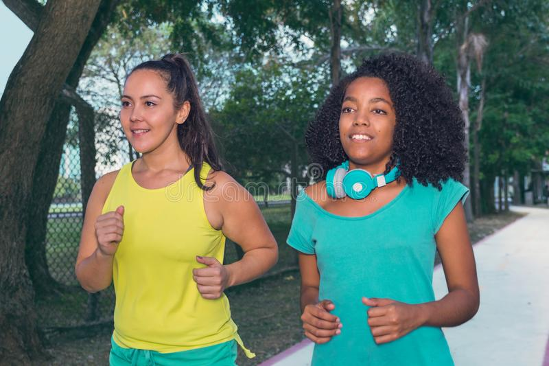 Sporty female friends training together. Cute black woman and pr royalty free stock photos