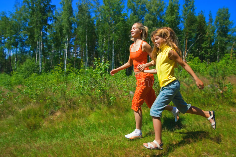 Download Two running girls stock photo. Image of happy, meadow - 2657126