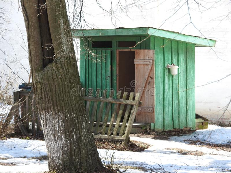 Two rural Outback wooden Toilets in winter park stock photo