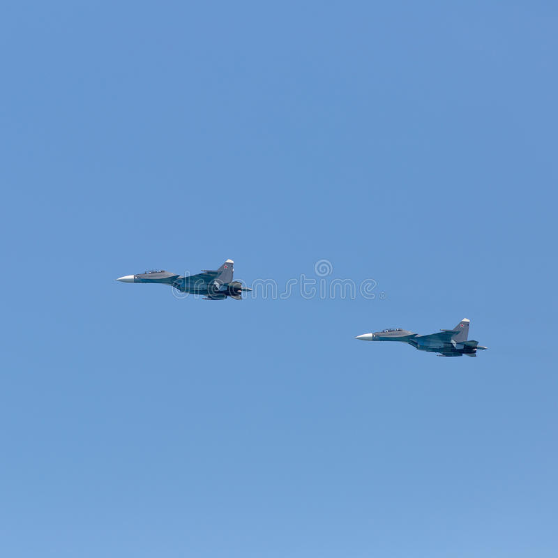 Two russian military jet planes Su-30 in sky. Flying of Su-30. Two russian military jet planes Su-30 in sky stock image