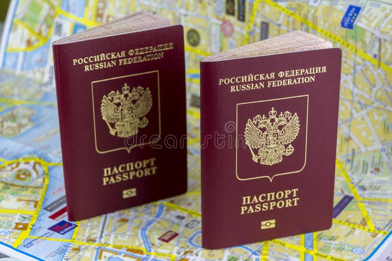 Travel concept. Two Russian passports on the background of a paper map of the city royalty free stock images