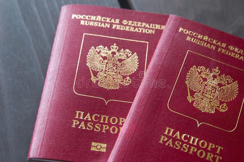 Two Russian Passports on wooden table. Closeup stock photo