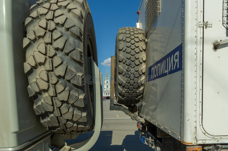Two russian police trucks closing way to square royalty free stock photo