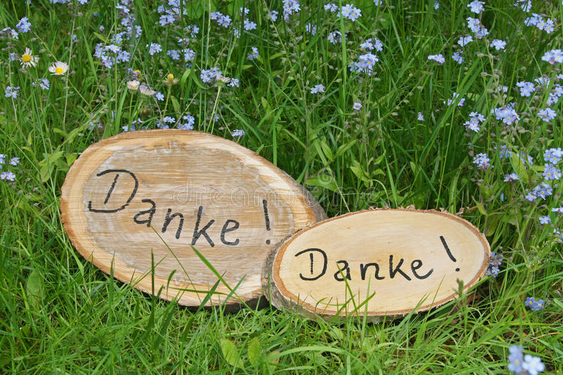 Two rustic tree slices with handwritten thanks oin the garden la royalty free stock images