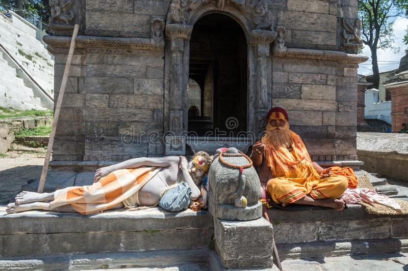 Two sadhus in the Pashupatinath Temple 13 April 2018, Kathmandu,. Kathmandu, Nepal – 13.04.2018 Two sadhus in the temple complex Pesonalised 13 April 2018 stock photos
