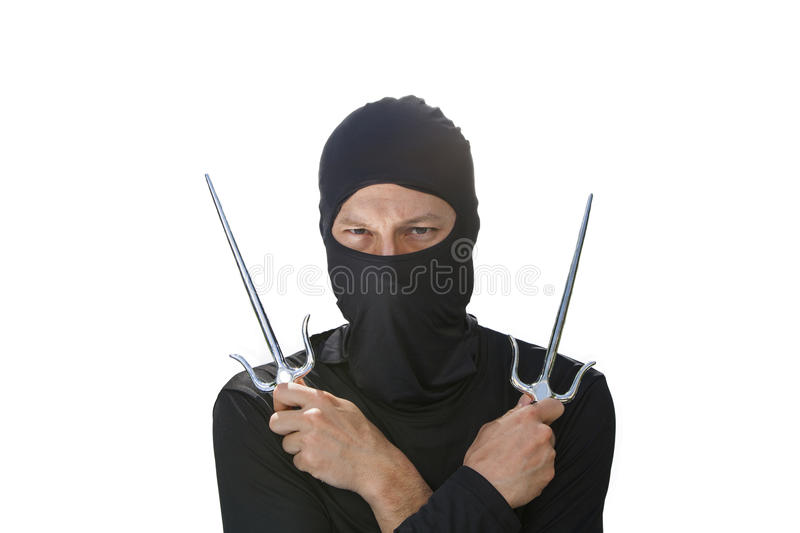 Two Sai. A ninja with two sai against a white background stock image
