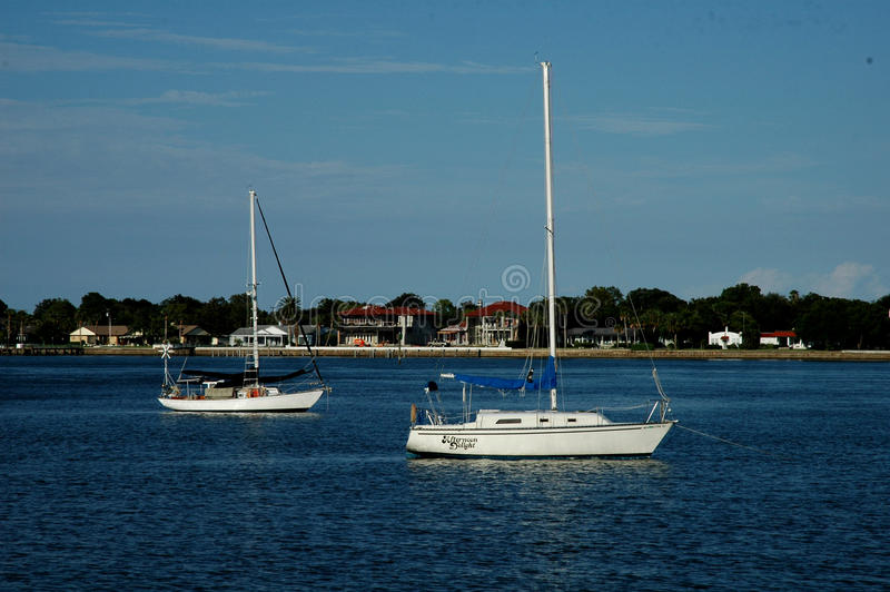 Two sailboats anchored royalty free stock images