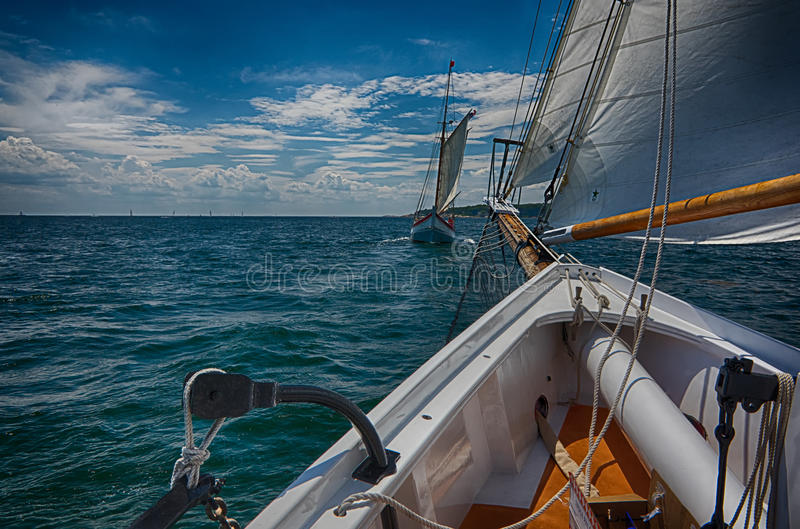 Two sailboats racing stock photography