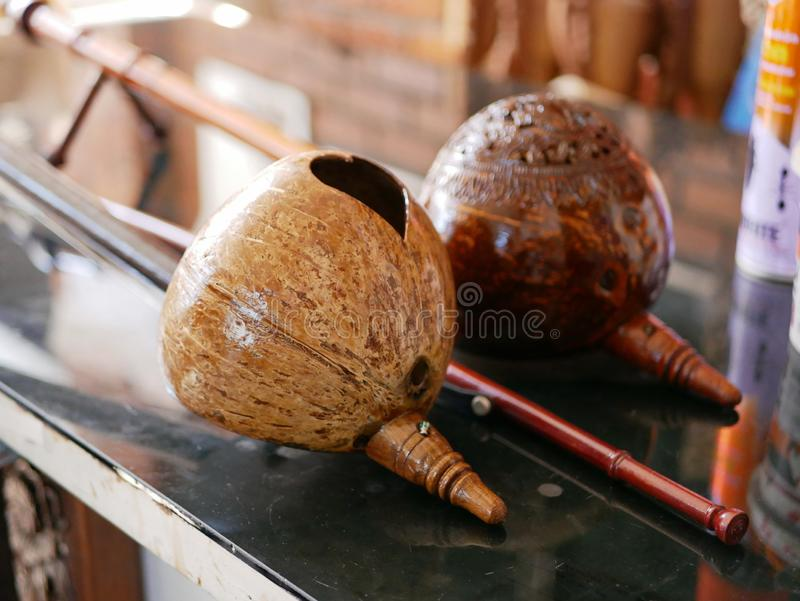 Two salors, two or three-string spike fiddle used in the Lanna region or in the North of Thailand, on a table. Selective focus of two salors, two or three-string royalty free stock photo