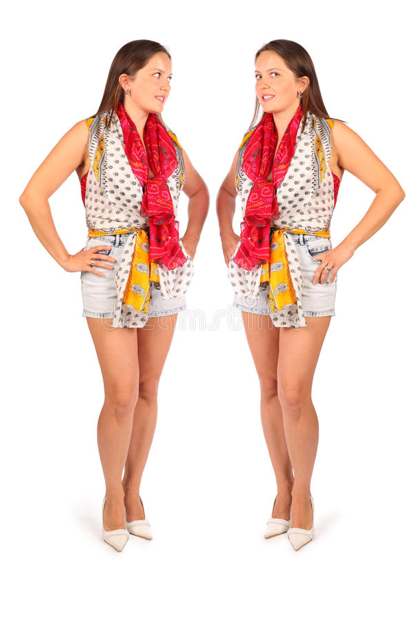 Two same women in studio on white background. Two same woman in studio on white background. First woman looks at camera and second woman looks at double royalty free stock photography