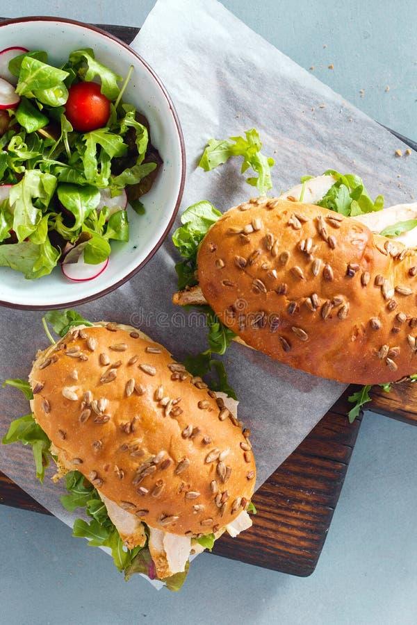 Two sandwich chicken wooden board top view healthy breakfast stock photo