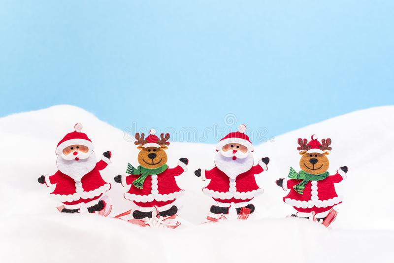 Two Santa Clauses and two reindeers. In the snow stock image