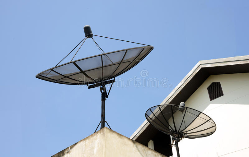 Two satellites. On the roof stock images