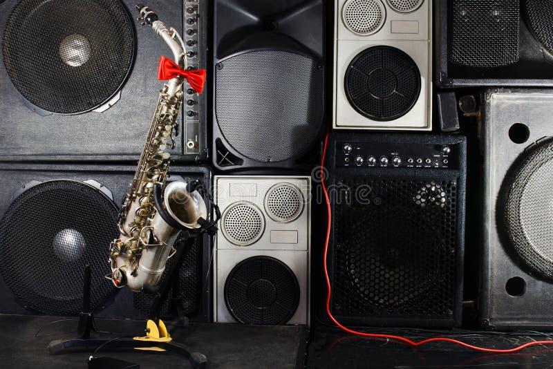 The saxophone on music studio equipments background stock image