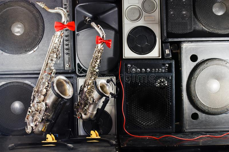Two saxophones on music studio equipments background royalty free stock image