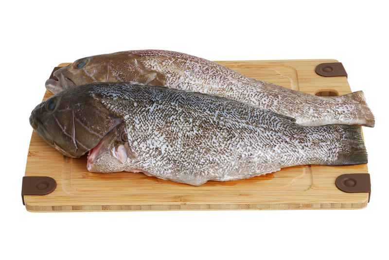 Download Two Scaled  Grouper Fish On Bamboo Cutting Board Stock Photo - Image: 18865910