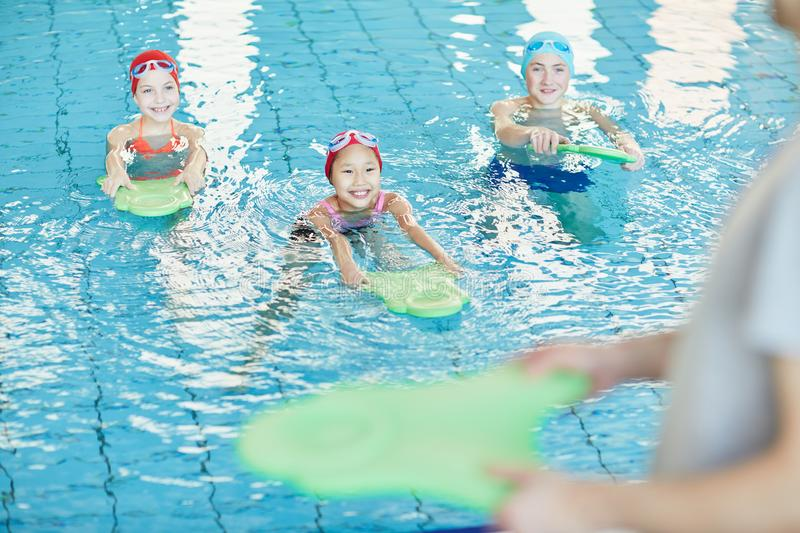 Kids swimming stock photography