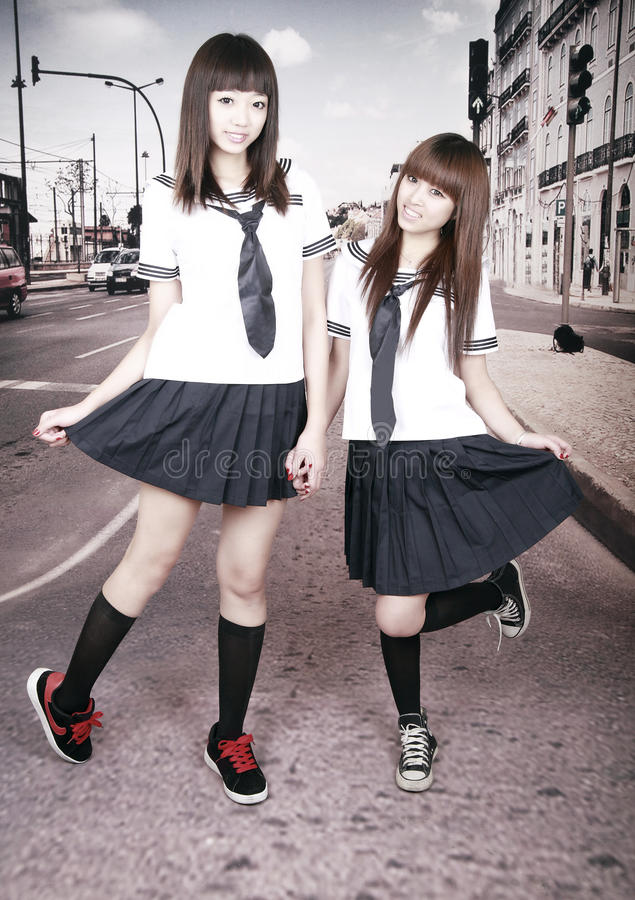 Download Two Schoolgirls Outdoors. Royalty Free Stock Image - Image: 12796376