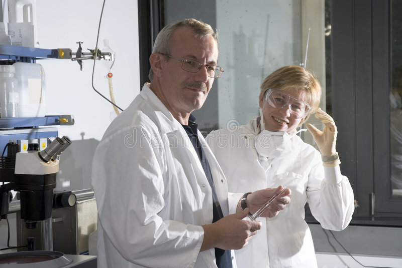 Two science technicians stock photo