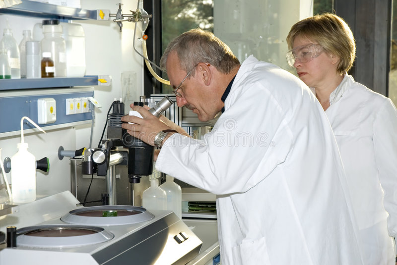 Two science technicians royalty free stock photo