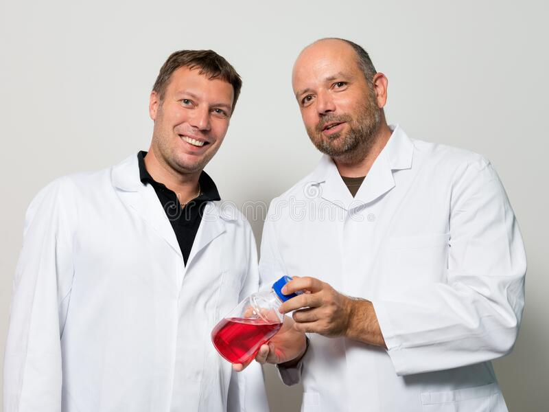Two scientists with a bottle royalty free stock photos
