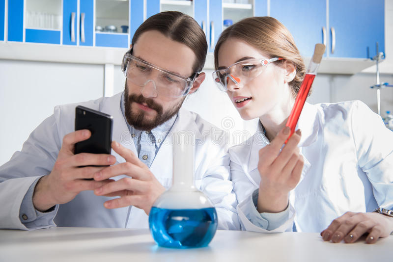 Two scientists working stock images
