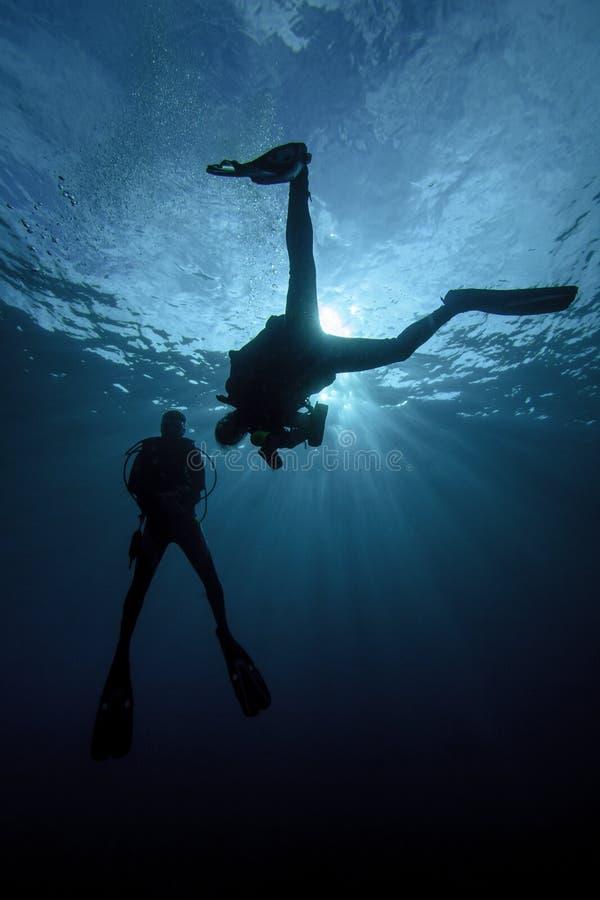 Two Scuba Diver Silhouettes stock photos