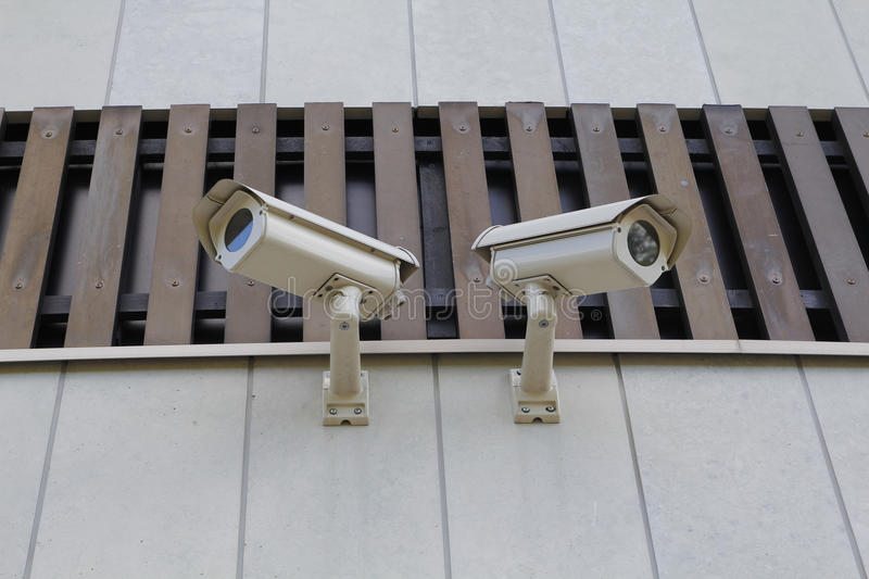 Two security cams royalty free stock photo