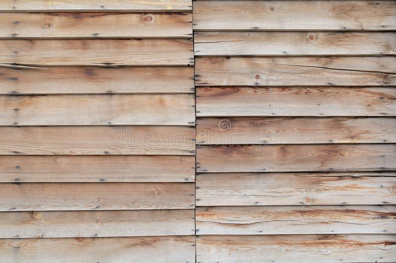 Two segments of overlaid planks material texture. Two segments of overlaid planks material royalty free stock photography