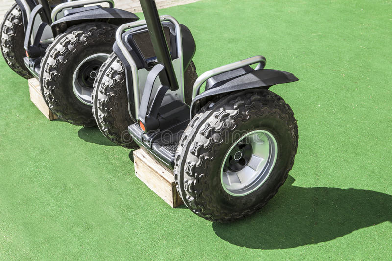Two segway vehicles with special tyres for nature routes stock photos