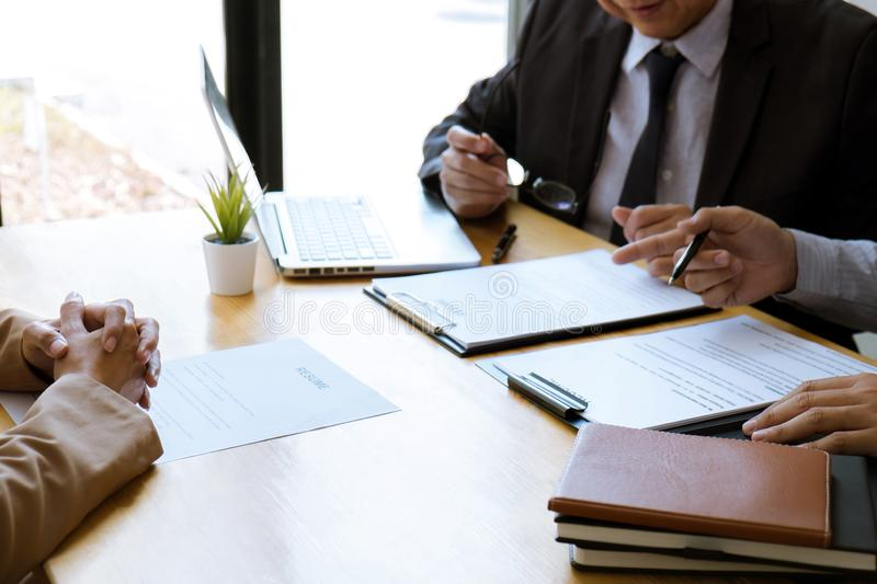Two selection committee manager reading a resume during a job interview, Employer interviewing to ask young female job seeker for. Recruitment talking in office stock images