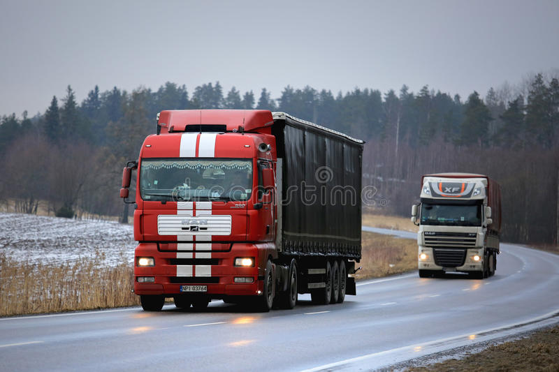 Two Semi Trailer Trucks on the Road in Winter stock photos