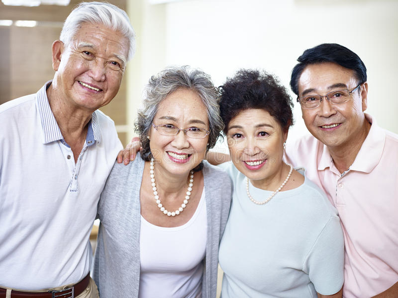Two senior asian couples getting together stock photos