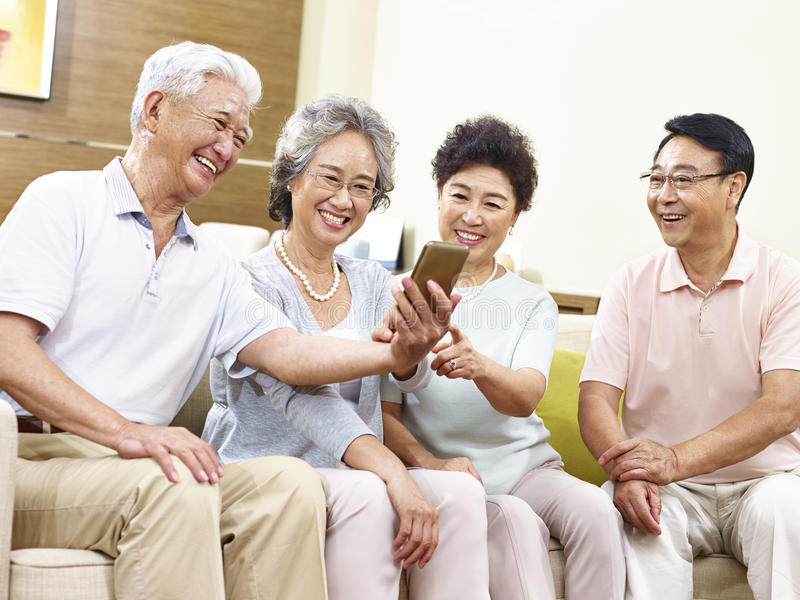 Two senior asian couples taking a selfie royalty free stock image