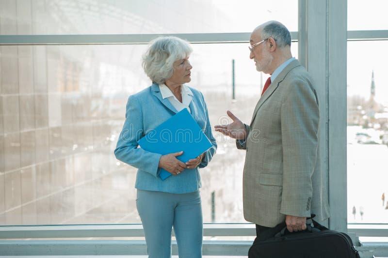 Two senior business people talking royalty free stock photos