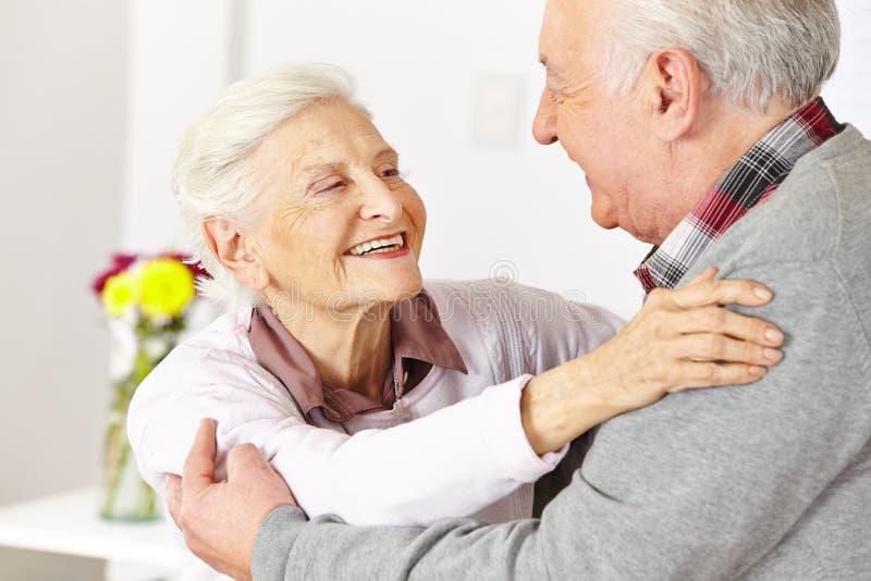 Two senior citizens dancing. Two happy senior citizens dancing and smiling in a dancing class stock photo