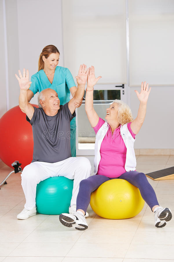 Two senior citizens doing sports in physiotherapy. During rehab stock photo