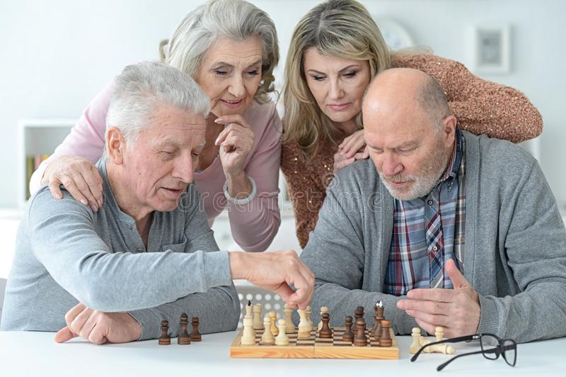 Senior couples using laptop royalty free stock photo